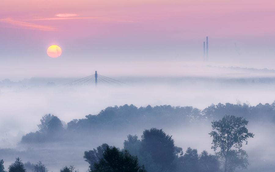 Sun over fogged Cracow