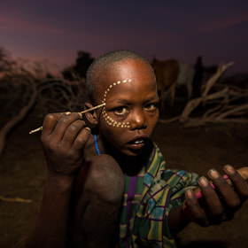 erbore tribe child with face painting