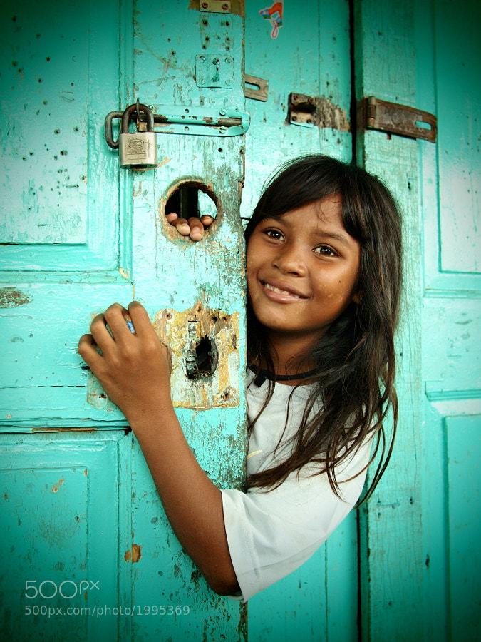 "Cute orang asli kid in Crab Island (Pulau Ketam), Selangor, Malaysia. Note: Orang Asli (lit, ""original people"", ""natural people"" or ""aboriginal people"" in Malay), is a general Malaysian term used for any indigenous groups that are found in Peninsular Malaysia."