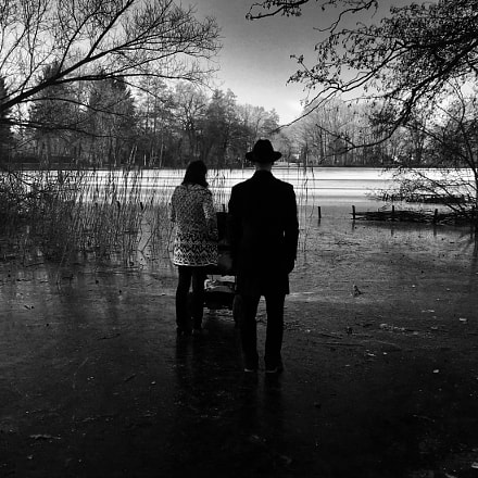 Small family on a frozen lake. Shot with iPhone.