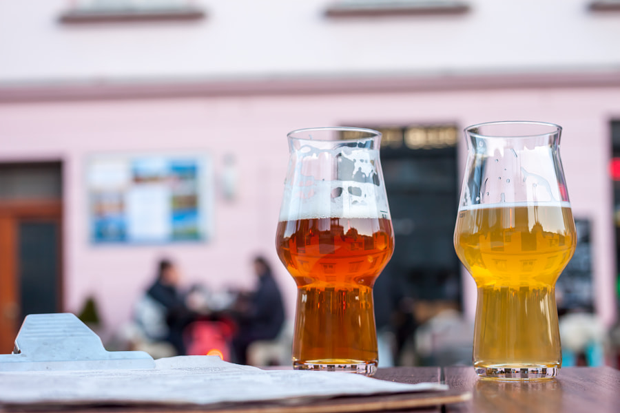 two glasses of beer on table edge by Anton Chechotkin on 500px.com