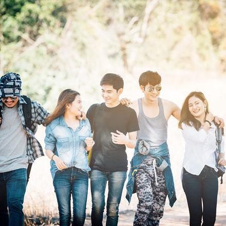 Asian traveler with friends, Group backpacks young walking toget