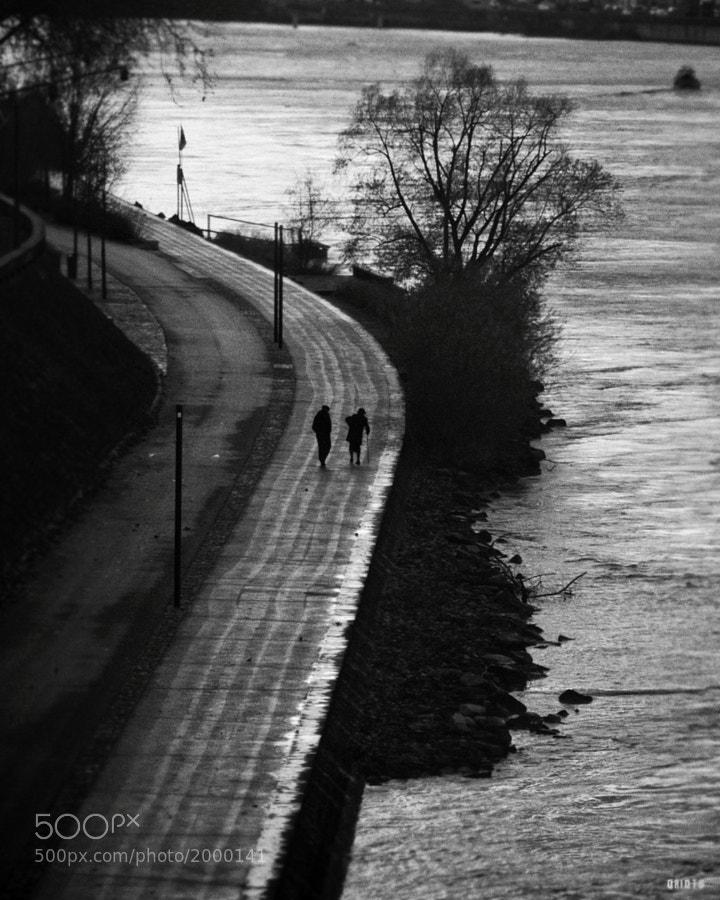 """An old couple walking in Lyon.  <a href=""""http://nightgrain.tumblr.com/"""" rel=""""nofollow"""">Photoblog</a>"""