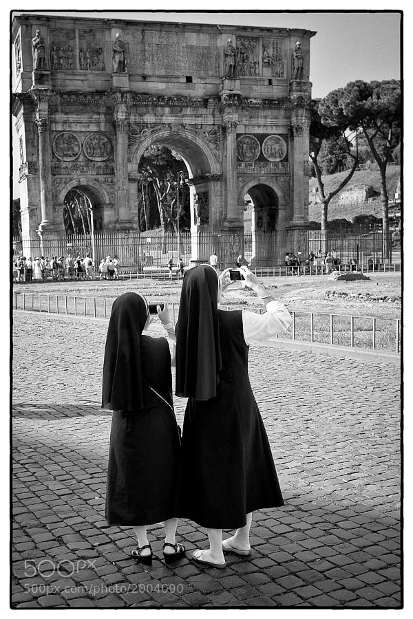 Two nuns take in the sights of Rome near the Colosseum