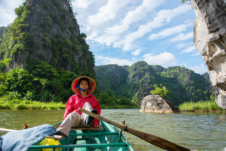 The woman is driving the boat in the river by Quang Vu on 500px.com