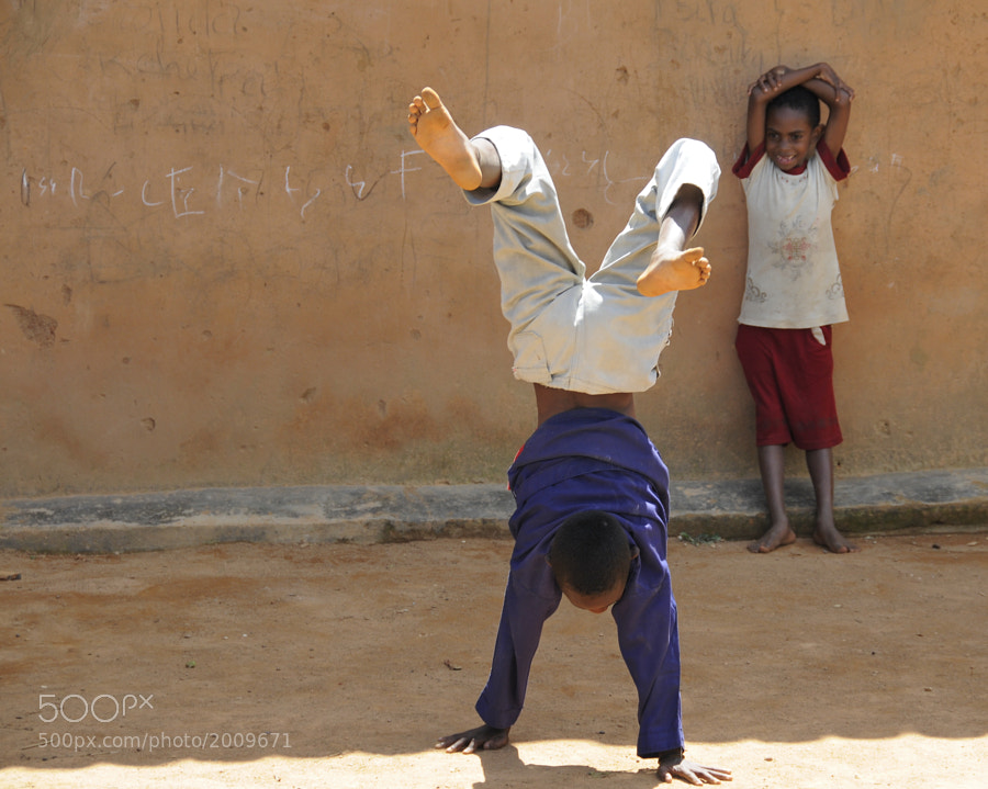 Malagasy children happily playing in front of their home in Antananarivo.