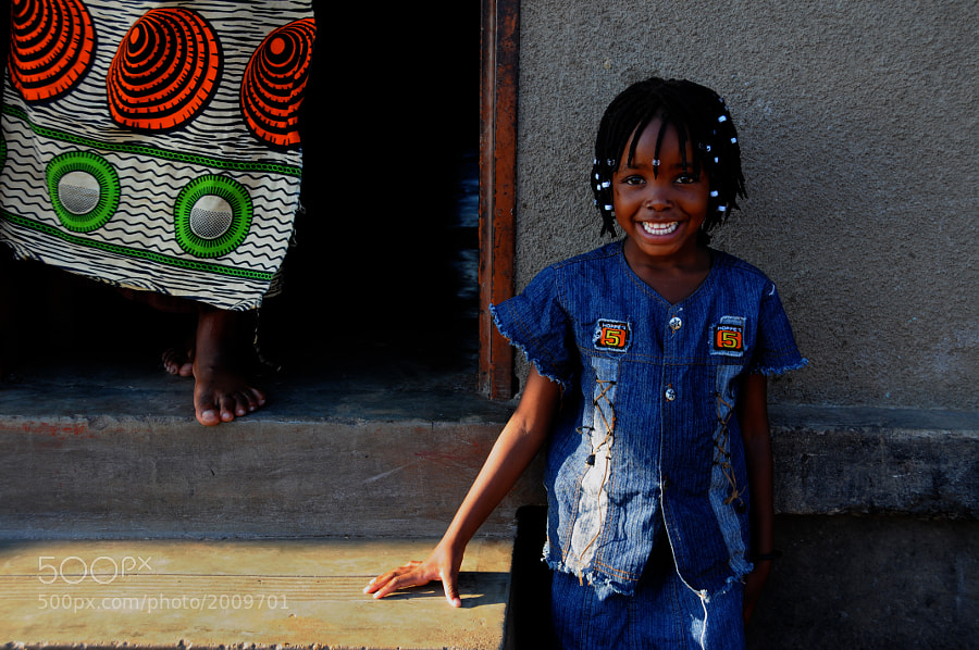 A beautiful Zambian smile greets me as I go to visit friends!