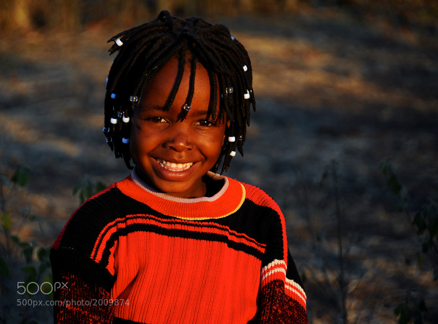Zambian girl smiling away at the world.