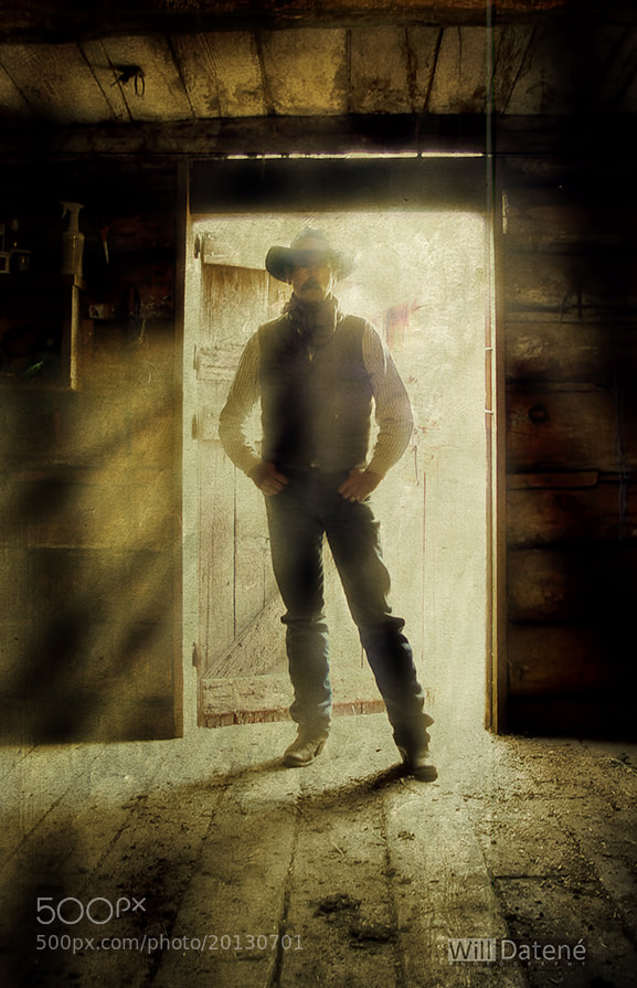 Photograph cowboy in doorway by Will Datené on 500px