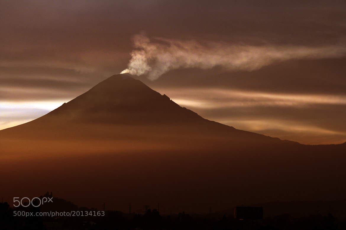 Photograph SUnset and smoking volcano by Cristobal Garciaferro Rubio on 500px