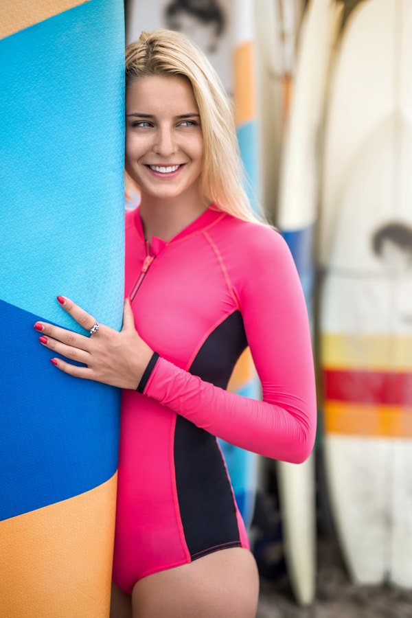 Girl with surfboard outdoors by Andrey Bezuglov on 500px.com