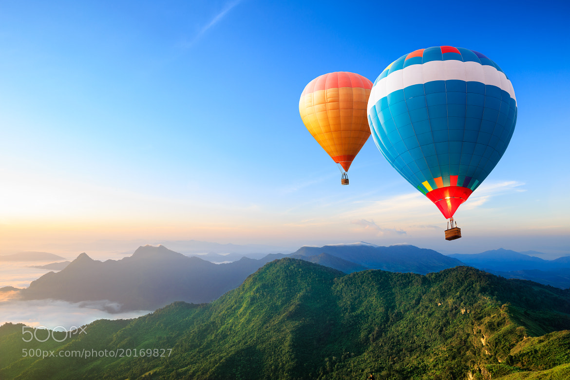 Photograph Colorful hot-air balloons flying over the mountain by patrick :) on 500px