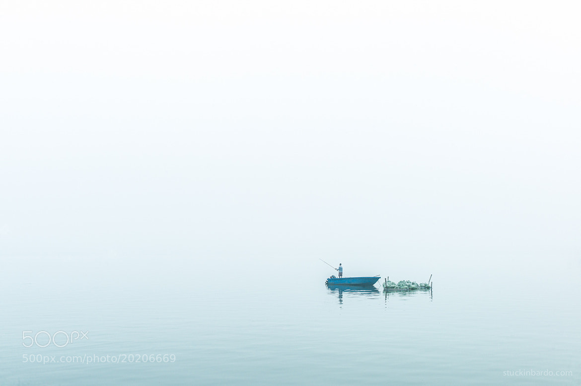Photograph West Lake Series: Man on a blue boat by Arthur Fuse on 500px