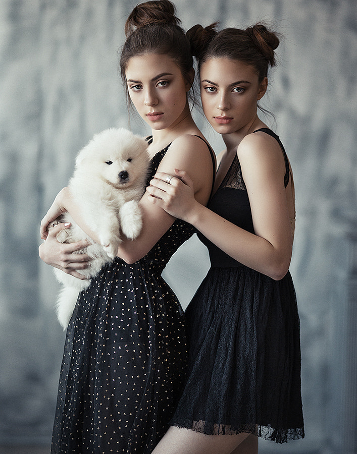 Girls with a puppy