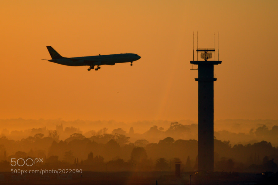 Early morning air traffic coming into the airport in Joberg, S.A.