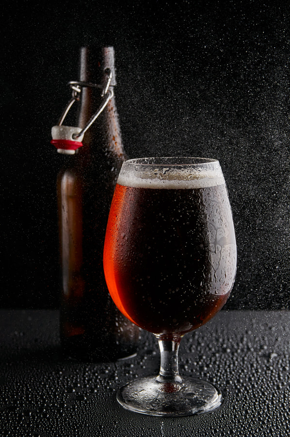 Beer in glass on a black background by Krzysztof on 500px.com