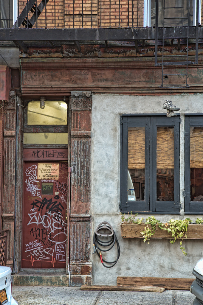 Photograph Graffiti on Door and Hanging Tennis Shoes by Scott Nelson on 500px