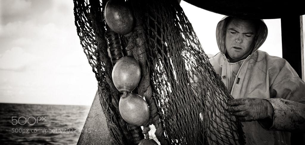 Photograph Fisherman at work by Hidde van der Ploeg on 500px
