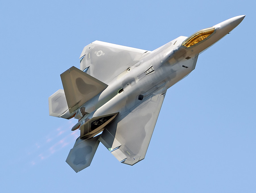 Major Henry 'Schadow' Schantz puts the F-22 Raptor through its paces during a demonstration flight
