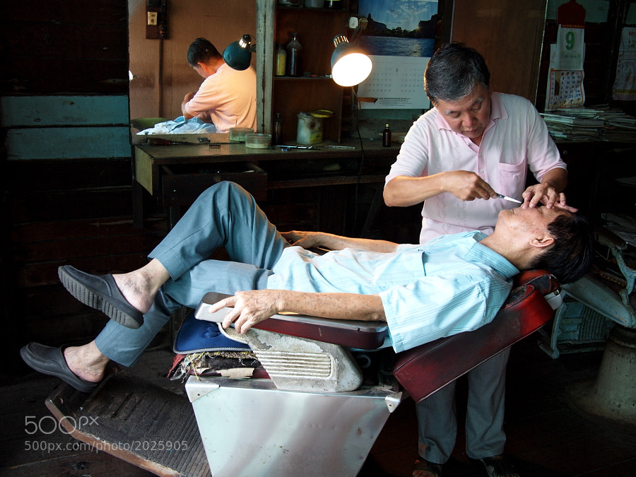 At a traditional Chinese barber shop in Crab Island (Pulau Ketam), Selangor, Malaysia.