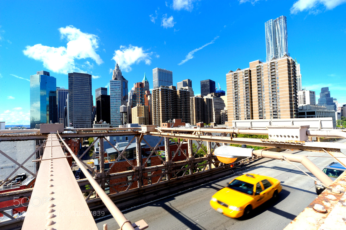 Photograph Manhattan view from The Brooklyn Bridge - 2 yellow cabs (1 expected, and 1 shot by pure coincidence) by Michael FRANCHITTI on 500px