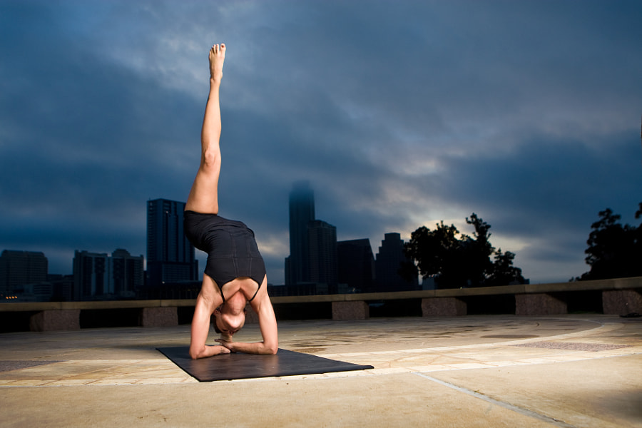 Austin, TX based yogini Sanieh practices yoga at sunrise at Austin's Long Center for the Performing Arts