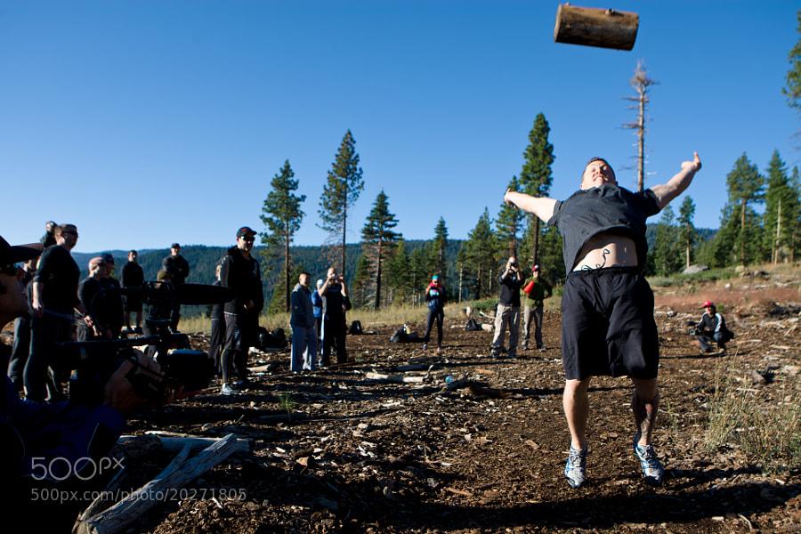 Matt Chan throws a log for distance