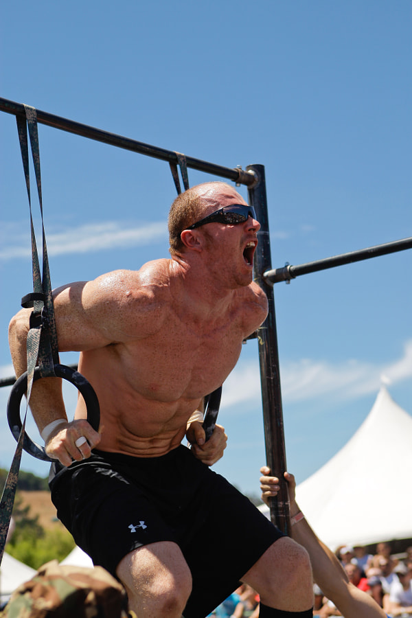 """Michael """"Big Mike"""" Gregory performs a muscle up during the final Affiliate Team workout of the 2009 CrossFit Games."""
