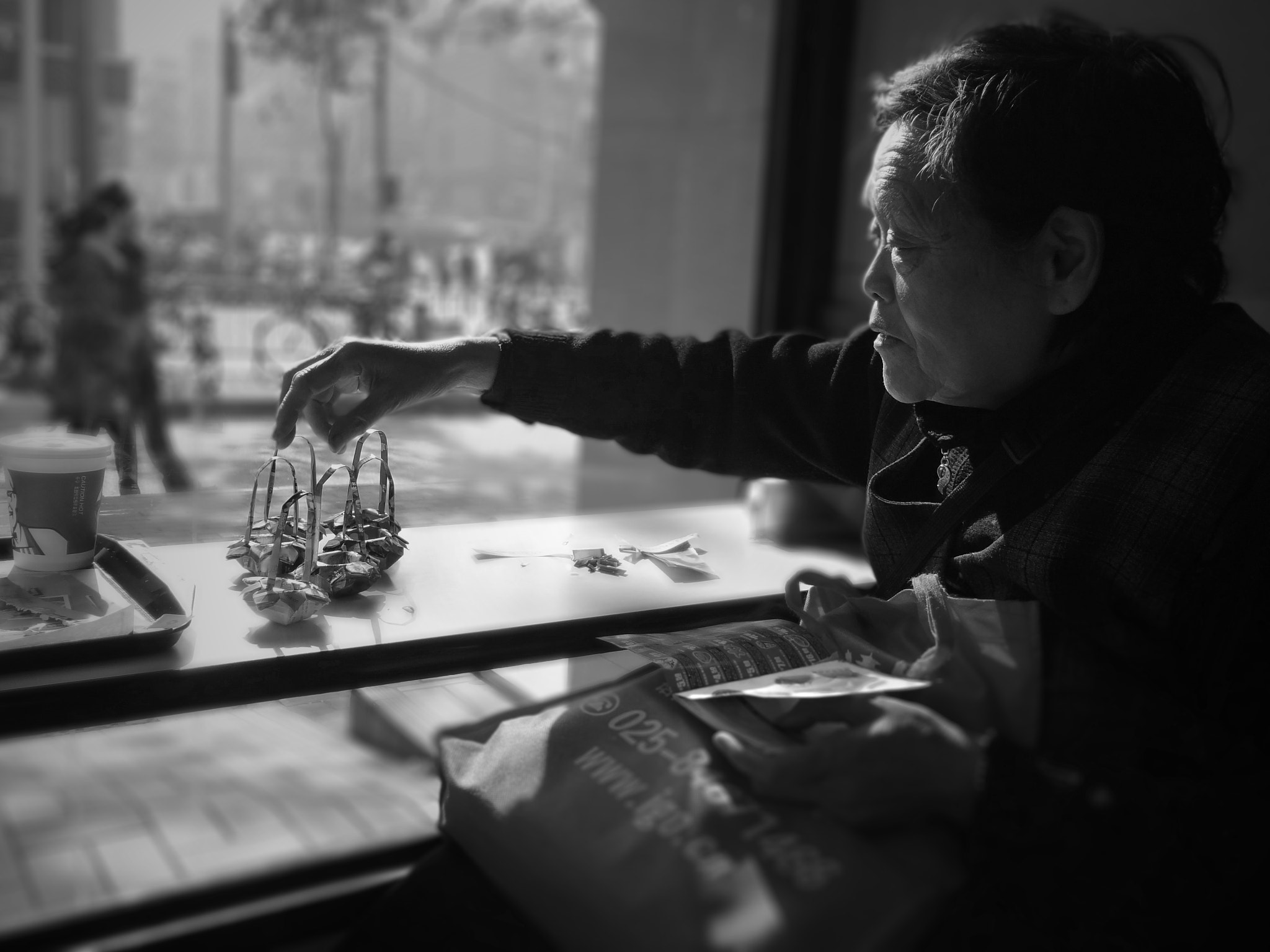 Photograph Old Woman Making Origami by Soleil Neon on 500px