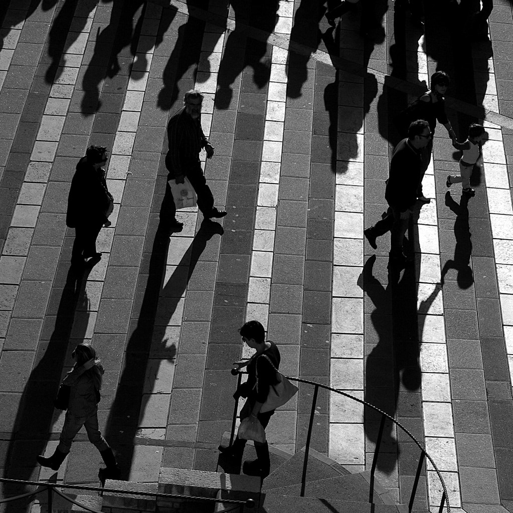 Photograph A dance of men and shadows by Walter Scappini on 500px