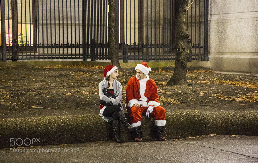 Photograph What is Santa telling her. . . by Sonny Hamauchi on 500px