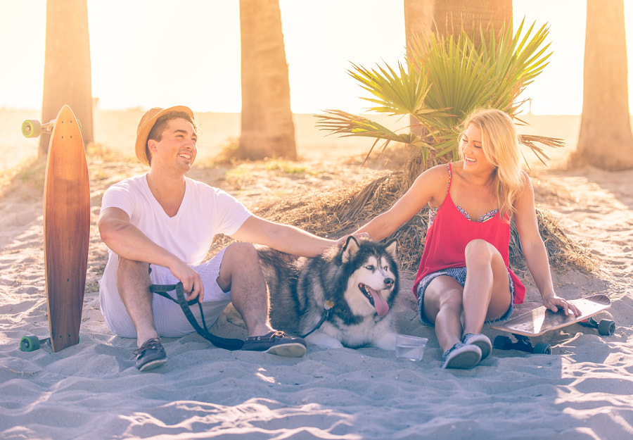 Couple having fun with their skates and playful husky by Cristian Negroni on 500px.com