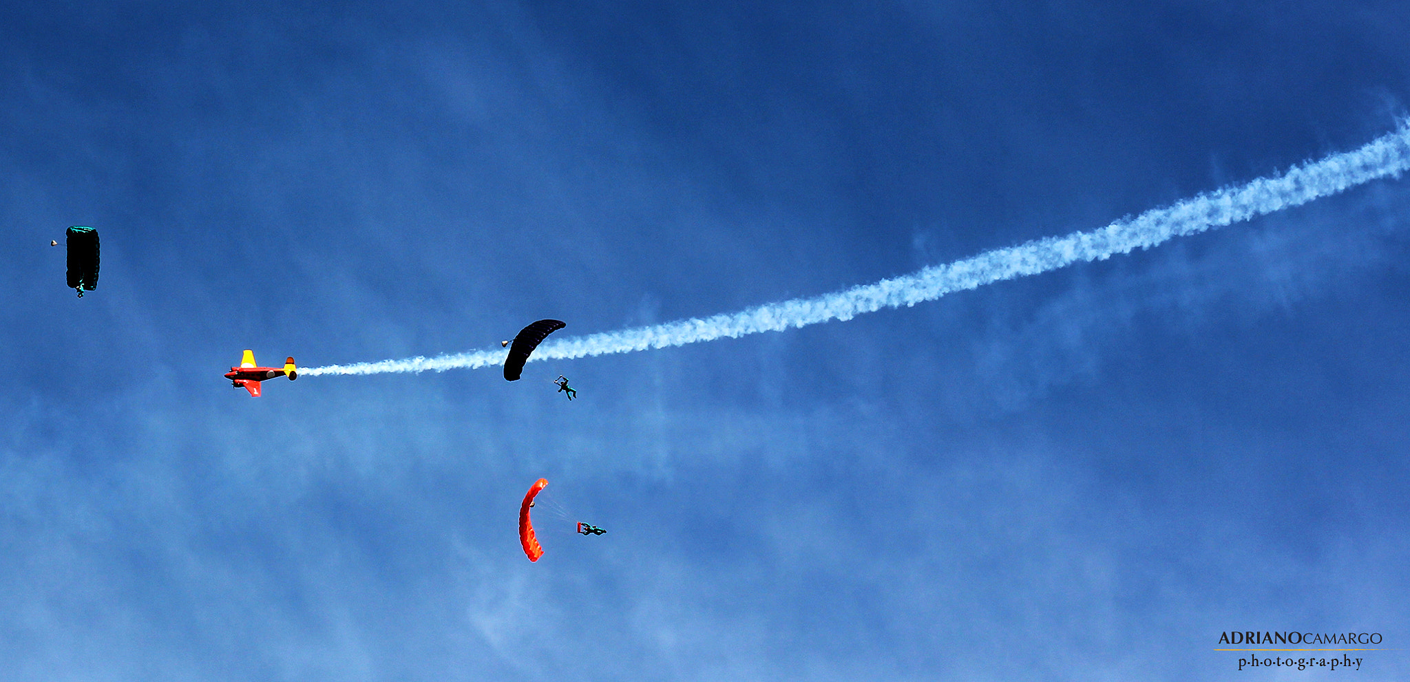 Photograph Three parachutes and a plane by José Adriano Camargo on 500px