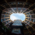 Viewing the sky within the atrium of the Gaudi building in Barcelona.