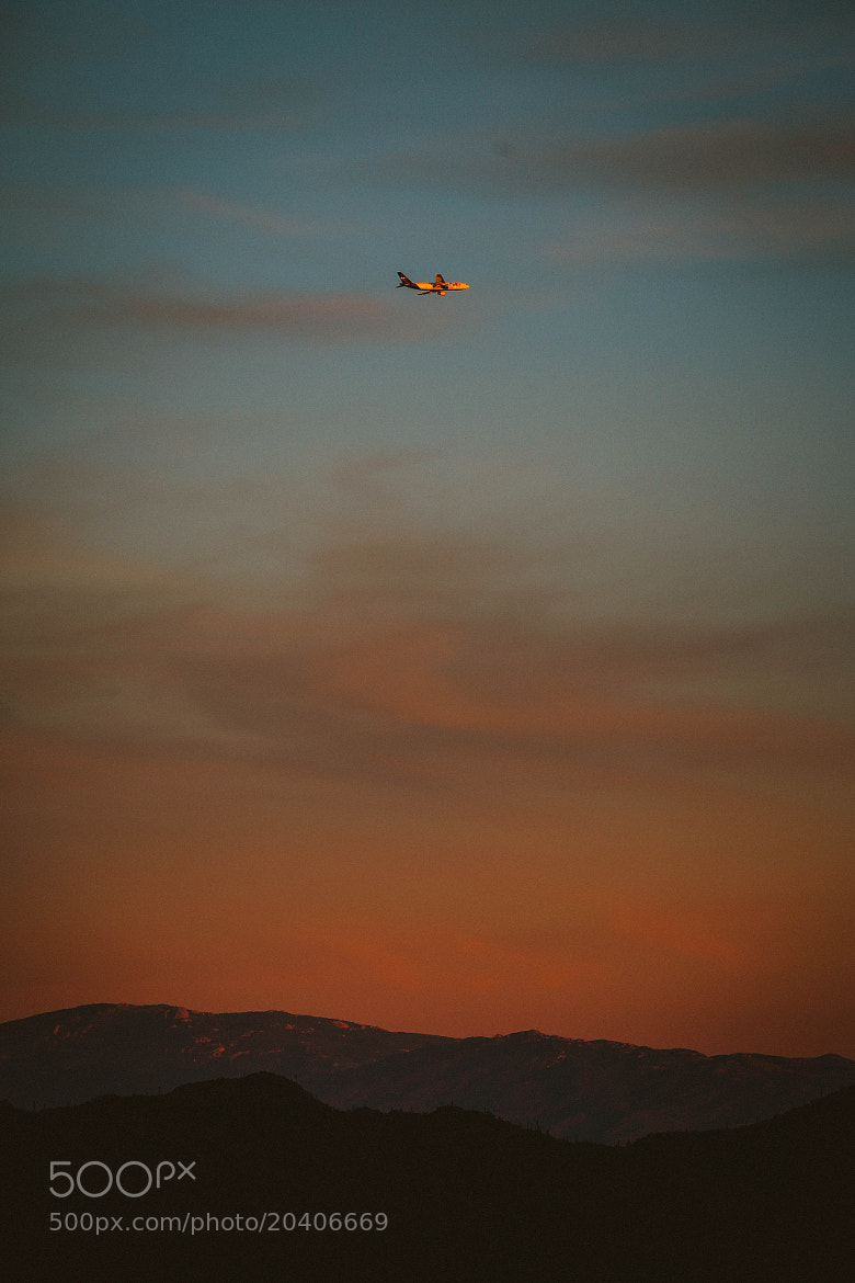 Photograph Plane over Tucson by Dave Dunmyre on 500px