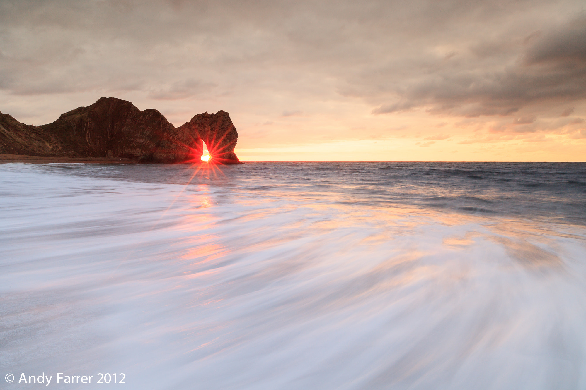 Photograph Durdle Door Starburst by Andy Farrer on 500px