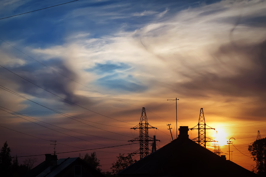 sunset... village... power lines