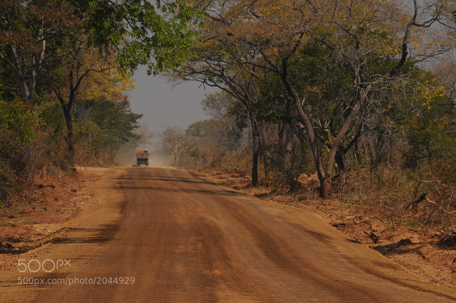 A work truck lumbers down the road in Zambia, just north of Livingstone.