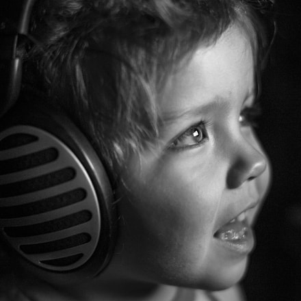 in headphones, Sony ILCE-7, Sony 50mm F1.4 (SAL50F14)