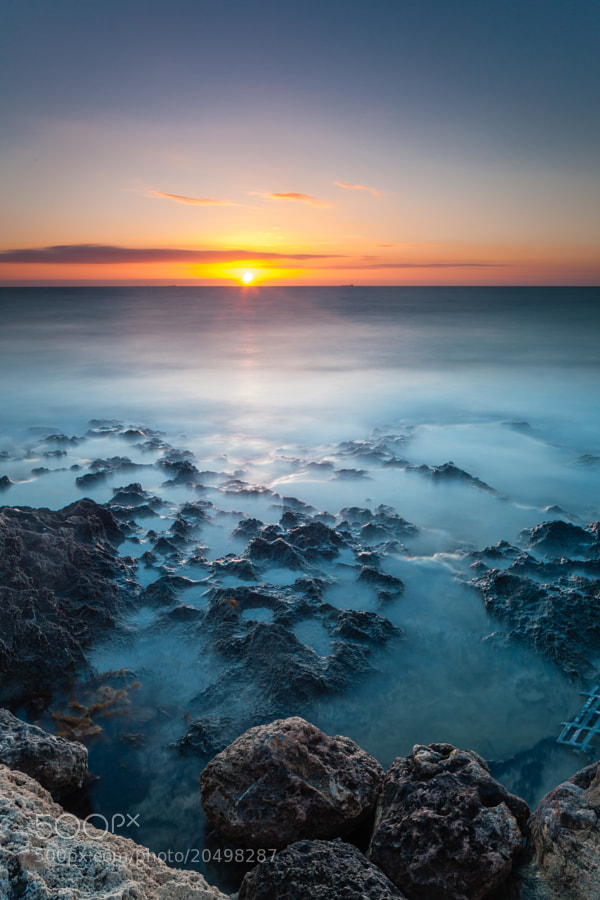 A long exposure of the interesting rocky coast at North Beach in Perth. 2 minute 40 second exposure. Using Hitech 0.9 Reverse ND Grad and Lee Big Stopper.