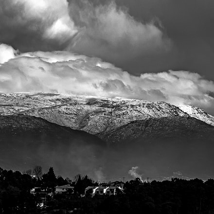 Clouds and snow., Canon EOS REBEL T1I, Sigma 18-200mm f/3.5-6.3 DC OS HSM [II]