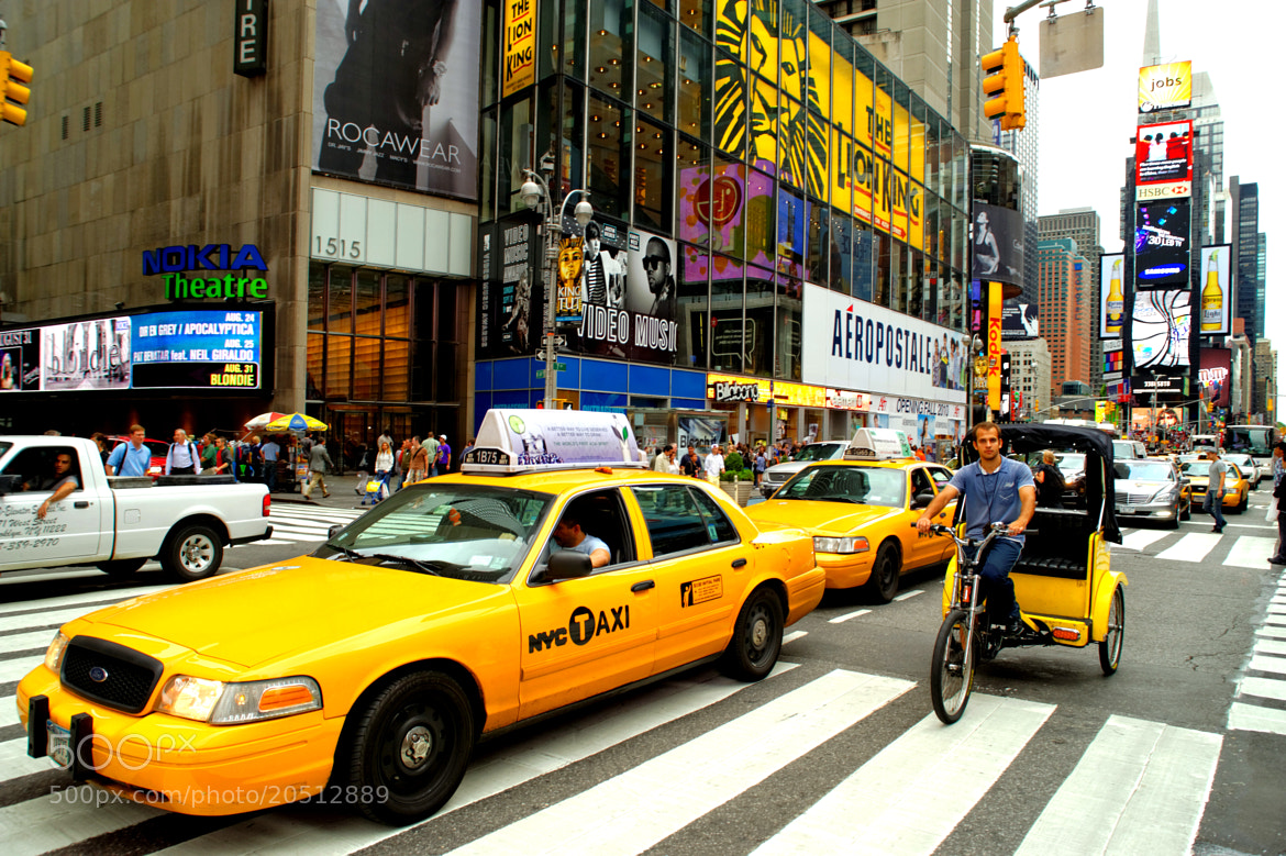 Photograph Times Square, The Crossroads of the World, with the famous yellow cab and yellow tricycle from NYC by Michael FRANCHITTI on 500px
