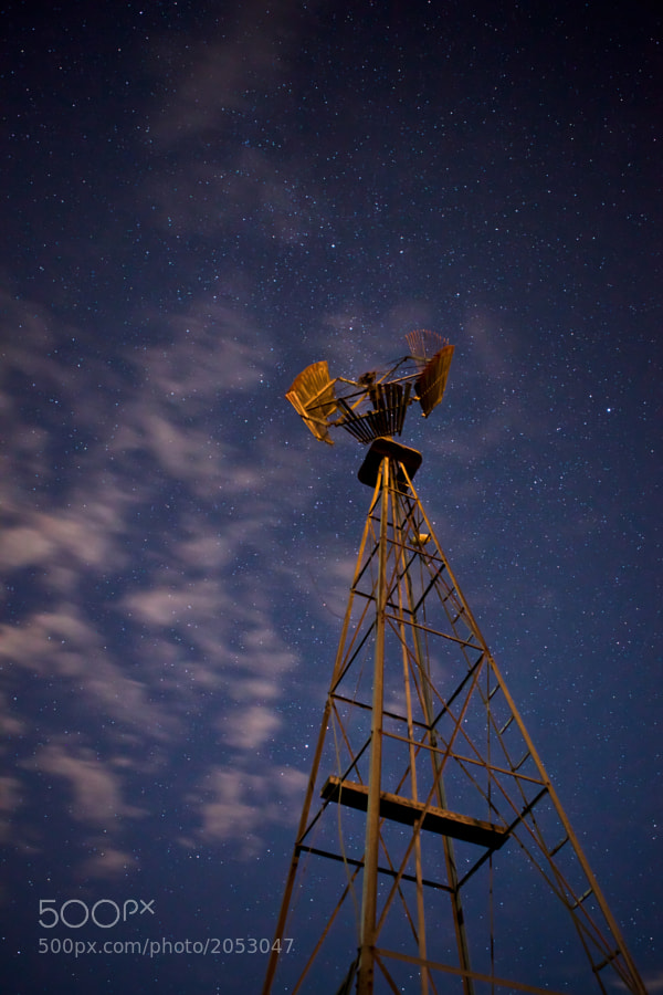 Itching to get out and do some more shooting. The moon is still 3/4 full and some light cloud on this particular evening. However, I didn't have to light paint...the moon and the flames from a nearby gas plant illuminated this old rusty windmill for me.