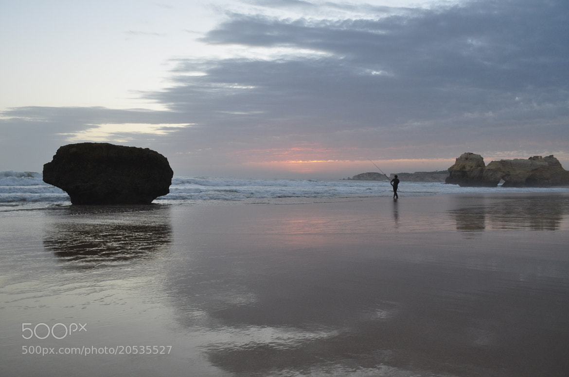 Photograph Fisherman on the beach by José Eusébio on 500px