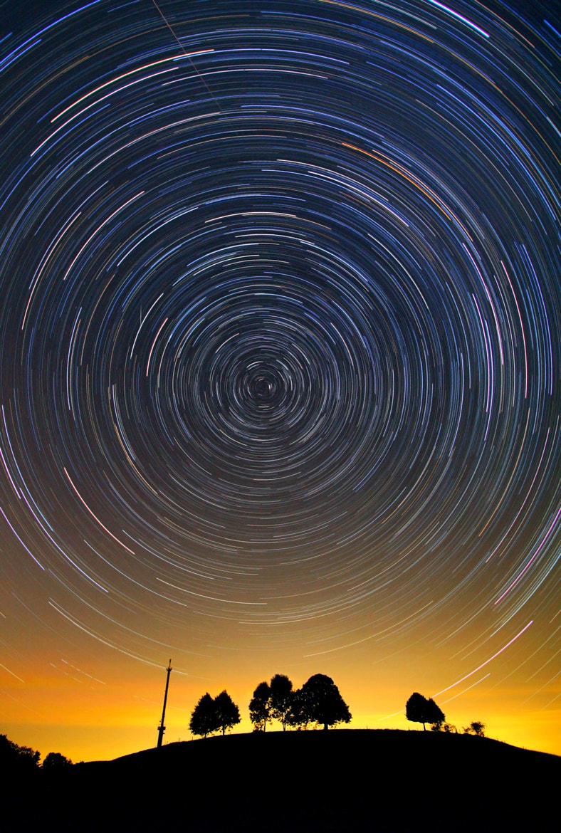 Photograph Star trails over bavarian hill by Christoph  Otawa on 500px