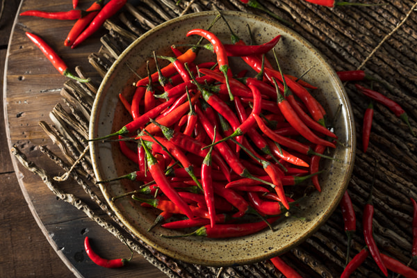 Raw Organic Red Thai Peppers by Brent Hofacker on 500px.com