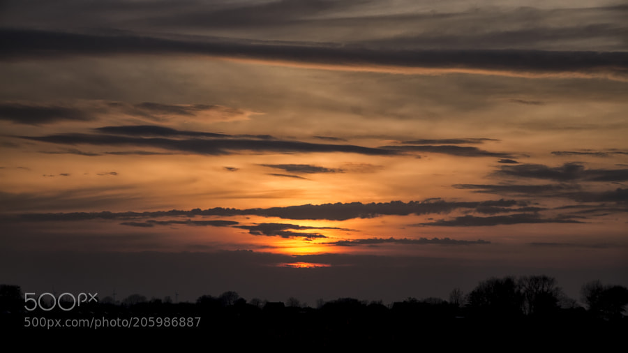 Long clouds at sunset