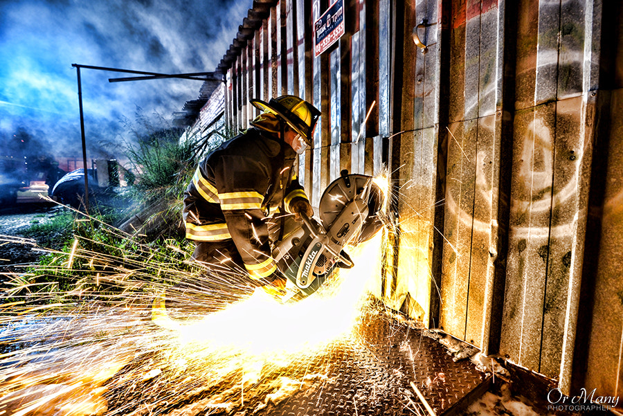 Photograph Firefighter breaks into a burning warehouse in Israel. by Or Many on 500px