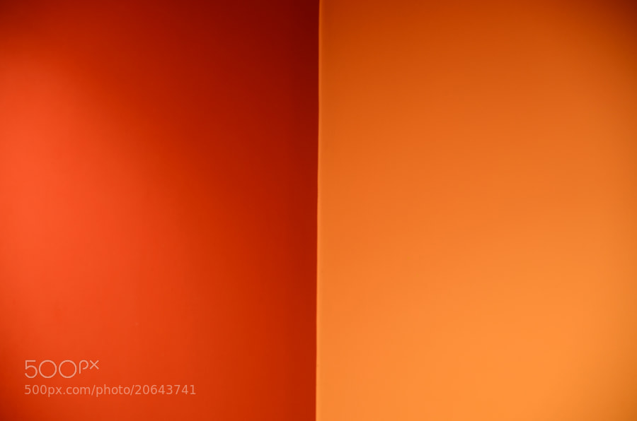 Orange and Red painted wall with light refelections