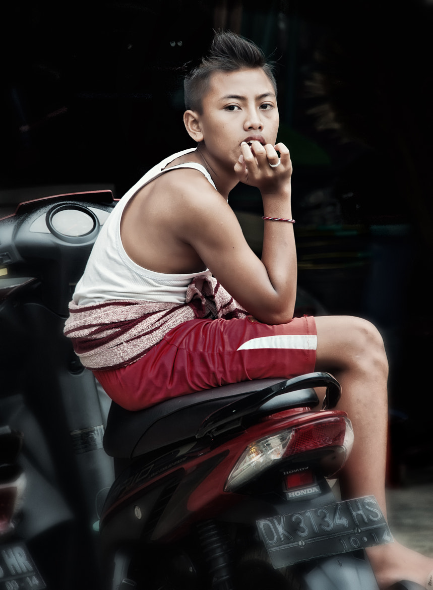 Photograph Balinese Boy on Scooter by Tom Coyner on 500px